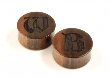 Custom engraved ear plugs > gothic lettering